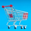 Shopping cart against background — Foto de stock #6410133
