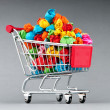 Recylcing concept with color paper and shopping cart — Foto de stock #6410188