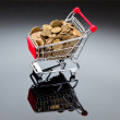 Gold coins in shopping cart — Stock Photo #6410654