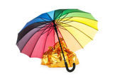 Golden sacks under protection of umbrella — Stock Photo