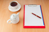 Binder with blank page and tea — Stock Photo