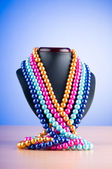 Pearl necklace against gradient background — Photo