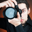 Stock Photo: Photographer with digital camera