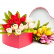 Stock Photo: Giftbox and tulips isolated on white