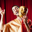 Actor with maks in a funny theater concept — Stock Photo #6485584