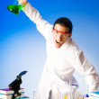 Chemist in the lab experimenting with solutions — Stock Photo #6591962