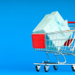 Gift box and shopping cart — Stock Photo