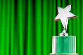 Star award against curtain background — Stock Photo