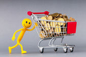 Smilies with shopping carts and coins — Foto de Stock