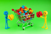 Recylcing concept with color paper and shopping cart — Stock Photo