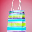 Shopping bags against gradient background — Stock Photo