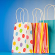 Shopping bags against gradient background - Stok fotoraf