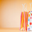 Shopping bags against gradient background - Foto de Stock  