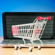 Stock Photo: shopping online with computer and cart