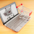Shopping online with computer and cart — Stock Photo #6610919