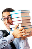Student with stack of books on white — Stock Photo