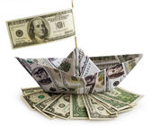Boat with american dollars — Stock Photo