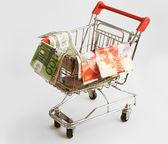 Carrello isolato con dollari, shekel ed euro — Foto Stock