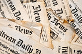 Background with ancient newspapers — Stock Photo
