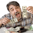 Man with american dollars and euro — Stock Photo