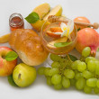 Stock Photo: Pomegranates, bread,grape and honey with ripe apple for Rosh Hashana