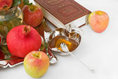 Pomegranates, torah,honey with ripe fresh apple for Rosh Hashana — Stock Photo