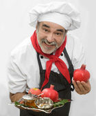 Chef with pomegranate,honey and apple for rosh hashana — Stock Photo