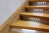 Staircase with wooden steps and illumination — Stock Photo