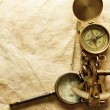 Stock Photo: Compass on vintage paper