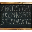 Alphabet handwritten on a blackboard — Stock Photo