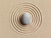 Zen stone in the sand — Stock Photo