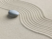 Zen stone in the sand — Stock Photo