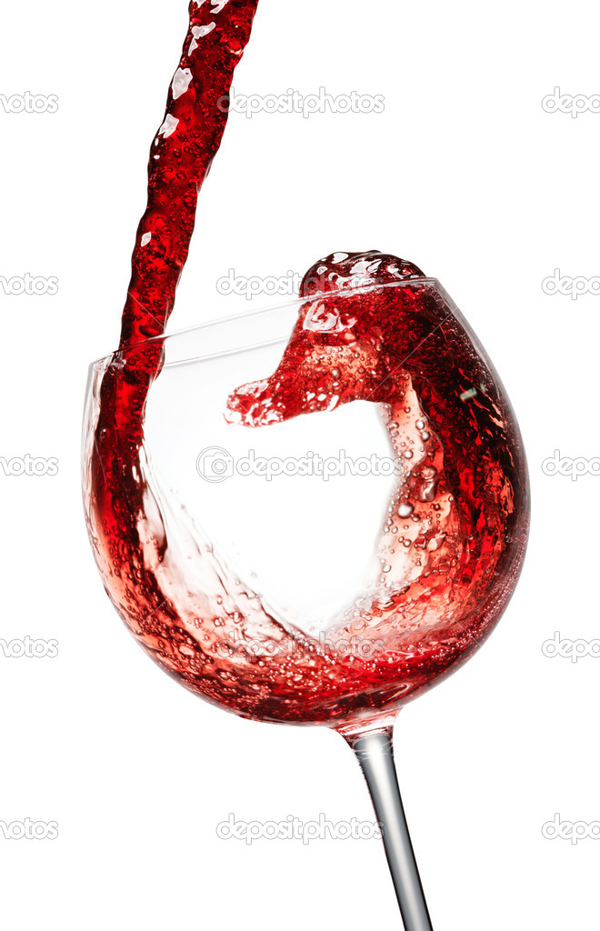 Red wine splashing in a glass, isolated on white  Stock Photo #5440612