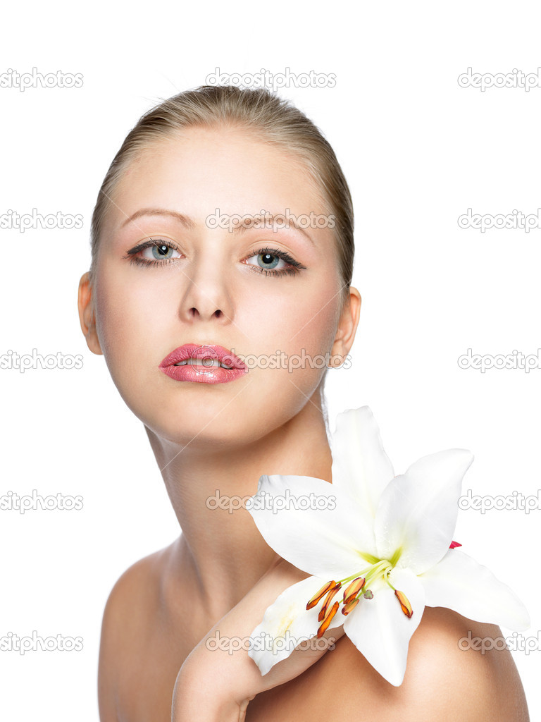 Beautiful young pretty woman with flower. isolated on white  Stock Photo #5442590