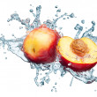 Peach in spray of water. — Stock Photo #5915788