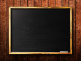 Blank chalkboard in wooden frame — Stock Photo