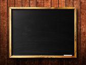 Blank chalkboard in wooden frame — Stock Photo