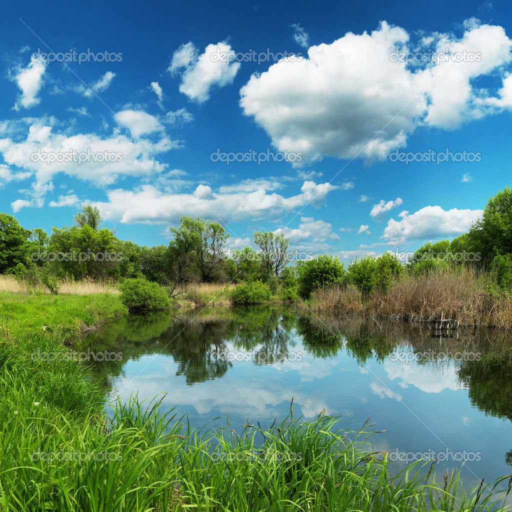 Summer landscape, river and blue sky - stock image