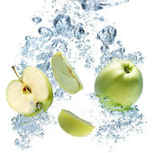 A background of bubbles forming in blue water after apple are dr — Stock Photo
