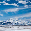 Panoramic landscape of snowy mountains in the spring — Stock Photo #5408705