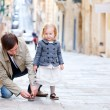 Father and daughter outdoors in city — Stock Photo #5560390