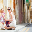Stock Photo: Mother and daughter portrait outdoors