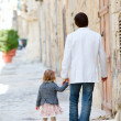 Stock Photo: Father and daughter outdoors in city