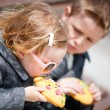Kids eating cookie — Stock Photo