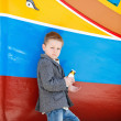 boy near colorful boat — Stock Photo