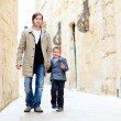 Father and son in city — Stock Photo