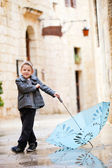 Cute boy on rainy day — Stock Photo