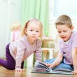 Brother and sister in kids room — Stock Photo