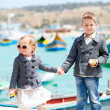 Kids in city near harbor — Stock Photo