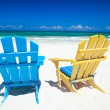 Colorful chairs on beach — Stock fotografie